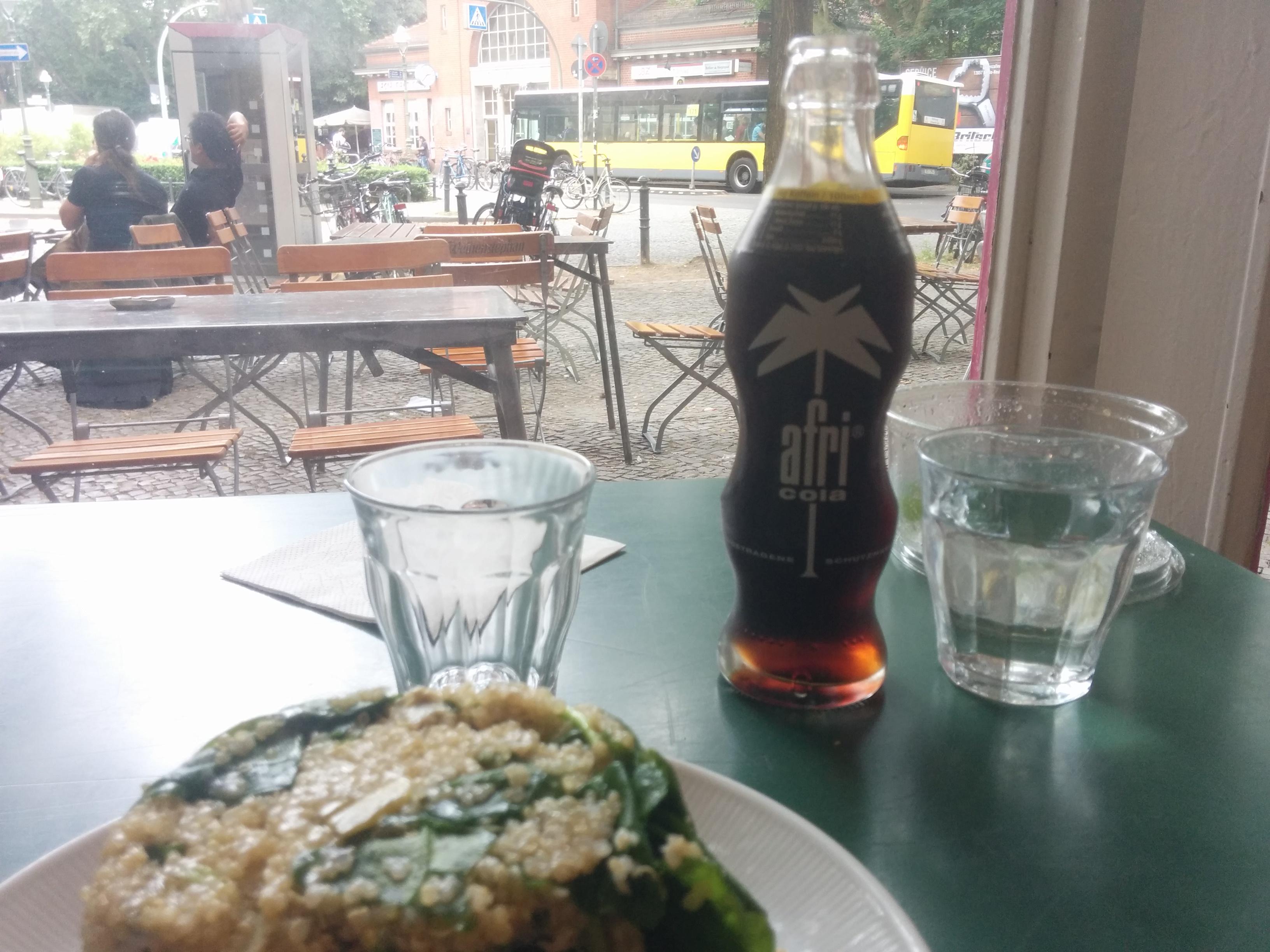 Salad and a bottle of Afri Cola.