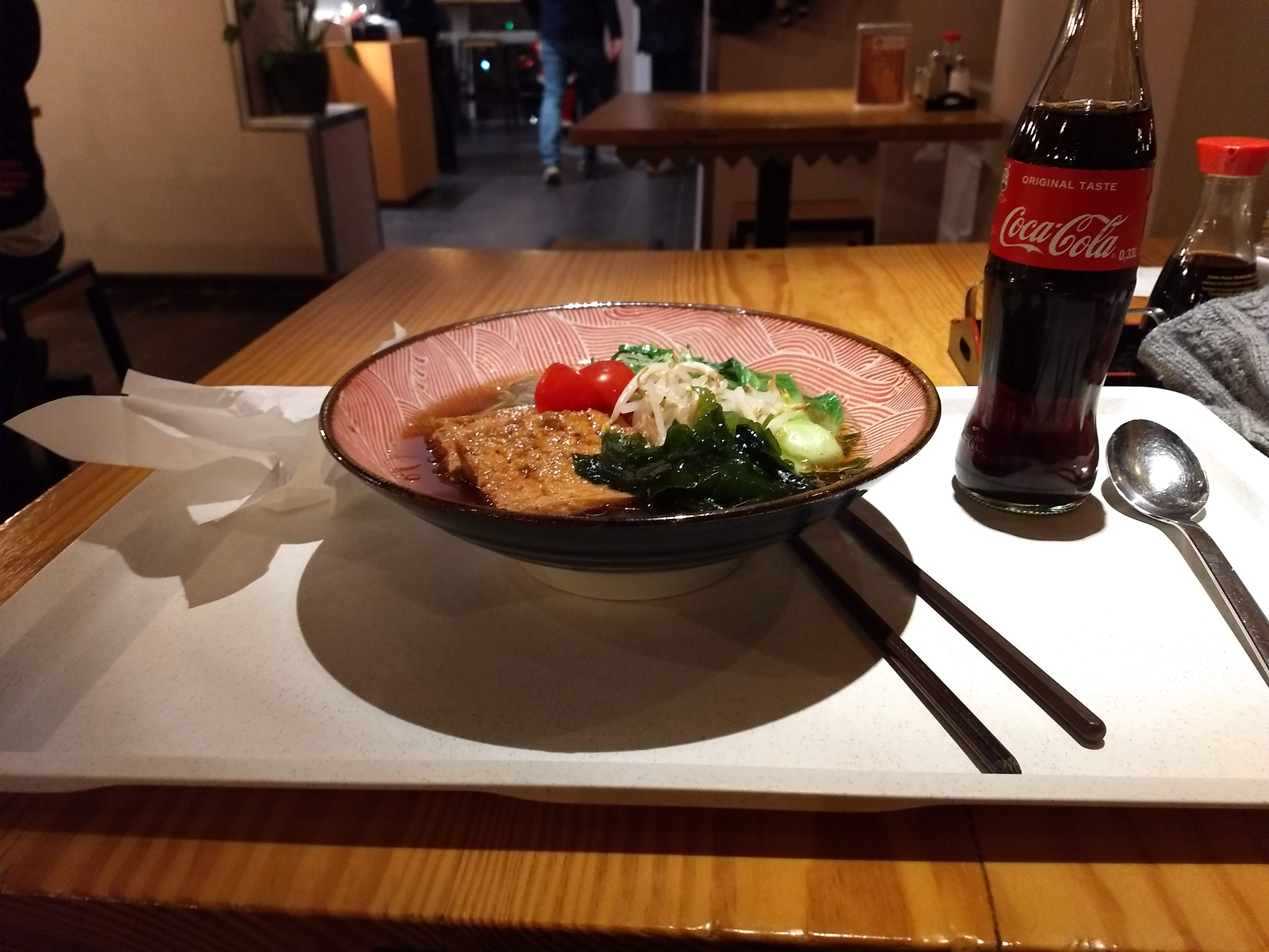 A bowl of sohyu and a bottle of coke.